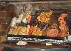 Asado-Uruguayan cuisine is based on European roots from Italy, Spain, Portugal and France, but also from  Germany and Britain, along with African/indigenous mixtures.Pasta, sausages, and desserts are common.  The Uruguayan barbecue, asado, is one of the most exquisite and famous in the world. A sweet paste, dulce de leche, is used to fill cookies, cakes, pancakes, milhojas, and alfajores. The alfajores are shortbread cookies sandwiched together with dulce de leche or a fruit paste..