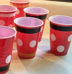 "Red solo cups I decorated for a Mickey Mouse birthday party, using 1"" diameter envelope sealers and colored electrical tape."
