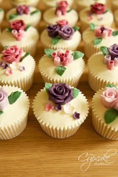 Vintage Rose Cupcakes | Handmade roses and rose buds on Orange flavoured cupcakes with Orange Blossom butter-cream frosting.