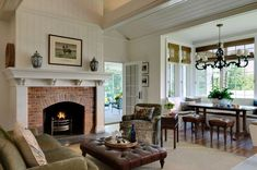 beautiful living room with brick fireplace