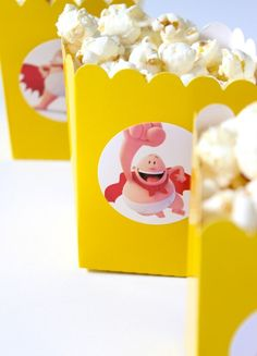 DIY Captain Underpants-Inspired Movie Night. popcorn boxes with captain underpants sticker on it.