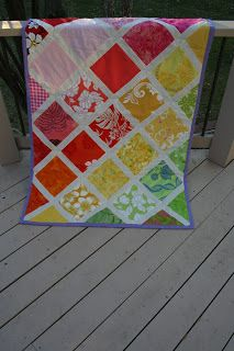 ByBryn - Hawaiian baby girl quilt  I really like the large scale, graphic prints used in this quilt!