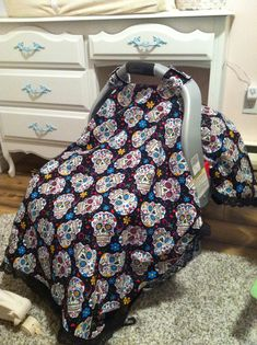 My diy sugar skull carseat canopy, debating adding a peek a boo slit..?