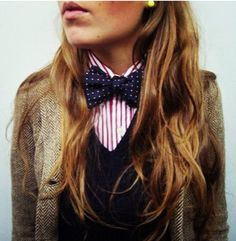 Tweed pink stripes and a spotty bow tie. And pearl earrings for added glamour.