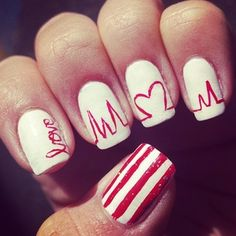 Another take on the heartbeat design, with some added flair. | 26 Ridiculously Sweet Valentine's Day Nail Art Designs