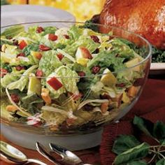 FESTIVE TOSSED SALAD - contest winner    Dressing:    1/2 cup sugar      1/3 cup red wine vinegar      2 tablespoons lemon juice      2 tablespoons finely chopped onion      1/2 teaspoon salt      2/3 cup canola oil      2 to 3 teaspoons poppy seeds  Assembly:    10 cups torn romaine      1 cup (4 oz) shredded Swiss cheese      1 medium apple, chopped      1 medium pear, chopped      1/4 cup dried cranberries      1/2 to 1 cup chopped cashews