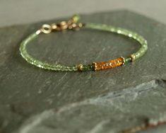 Small fine natural green peridot and green jade surround vibrant Mandarin orange garnet with small gold beads in this tiny bead bracelet. Bracelet Love, Peridot Jewelry, Gemstone Bracelets, Gemstone Jewelry, Jewelry Bracelets, Seed Bead Jewelry, Beaded Jewelry, Handmade Jewelry, Bead Jewelry