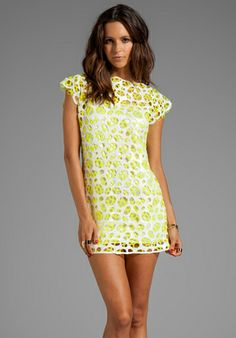This dress is ADORABLE, but then again. There's only one size, XS, and it's $1,617.00. Not that adorable.  -AGAIN Muffie Sequin Dress with Silk Slip in Vain Yellow