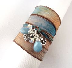 Hand Dyed Silk Ribbon Wrap Bracelet with Amazonite Briolettes, Swarovski Crystal, Buddha, and Peace Sign Charms $35.00 #jewelry #gift