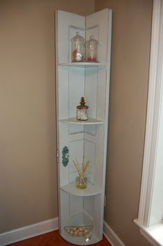 Salvaged Door Repurposed to Corner Shelf via Etsy