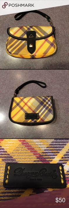 Dooney & Bourke Plaid Wristlet NWOT Cute Dooney & Bourke Plaid Wristlet. Never used. Fun plaid colors. Detachable wrist strap. Perfect size for phone, cards, and keys. A great spring treat for you! Dooney & Bourke Bags Clutches & Wristlets