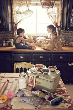 I love everything about this photo. The kids, the light the kitchen - oh my, the kitchen. Stunning work.