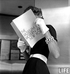 Nina Leen: Model Jean Patchett modeling cheap white touches that set off expensive black dress. 1949