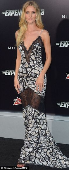 Blonde beauty: Rosie Huntington-Whiteley displayed her model looks in a sleeveless gown with a plunging neckline at the Expendables 3 premiere http://dailym.ai/1vE2s1i