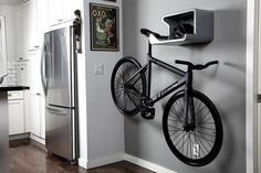 space-saving bike storage ideas for small apartments. Indoor bike storage solutions are for people who can't part with their bicycle. Hanging Bike Rack, Indoor Bike Rack, Indoor Bike Storage, Bike Hanger, Bike Storage Rack, Bicycle Rack, Indoor Cycling, Bicycle Wall Mount, Bike Mount