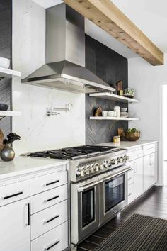 Get inspired by Modern Farmhouse Kitchen Design photo by TERRACOTTA DESIGN BUILD. Wayfair lets you find the designer products in the photo and get ideas from thousands of other Modern Farmhouse Kitchen Design photos. Kitchen Stove, Kitchen Tiles, Kitchen Colors, New Kitchen, Kitchen Cabinets, Dark Cabinets, Black Kitchens, Cool Kitchens, Kitchen Black