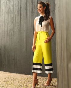 Neon yellow cropped flare pants with black and white stripes trim ad4fddd908b