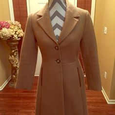 Prada coat Beautiful prada 100% wool gently used hate to part from it doesn't fit anymore, it has leather trim on the pockets Prada Jackets & Coats Pea Coats
