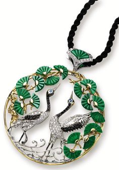 """Crane and pine"" pendant. The circular openwork pendant centring on two cranes set with brilliant-cut diamonds and black diamonds, accented by blue sapphire-set eyes, to a surround of pine trees set with fan-shaped jadeite plaques of emerald green colour, the diamonds together weighing approximately 1.30 carats, accompanied by a black cord, mounted in 18 karat yellow and white gold, length approximately 580mm.  Plaques approximately 7.27 x 9.93 x 1.17mm to 6.43 x 12.01 x 1.82mm. Via…"