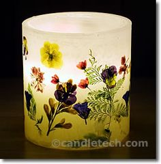 Pretty!  This is a tutorial for making a luminary out of wax.  I've always wanted to try this with water for an ice luminary!