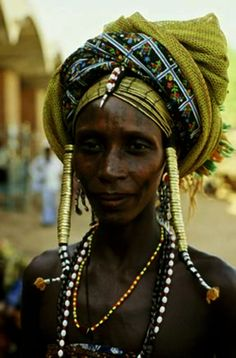 Pulaaku, the Fulani way: Yankinaare means Modesty, not just in clothing, but also in the tone of voice, and facial composure.  Wodaabe (Bororo Fulani) woman.  Garoua, Cameroon.  1980.© Harri Peccinotti.
