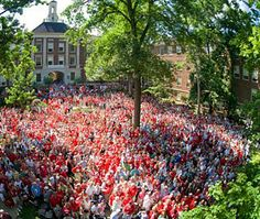 """During Alumni Weekend 2009, Miami University held a """"Merger Moment"""" ceremony. 1,087 couples renewed their wedding vows near the Upham Arch, setting a new record for the highest number of wedding vow renewals at a single time."""