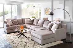 For those who love to host, a space with ample seating is an absolute must. Our Ellison sectional allows you and your social network to congregate and confide in one place, and its generous proportions, deep cushions and lustrous taupe upholstery make every get-together better. See more inspiring living rooms. #LivingSpaces