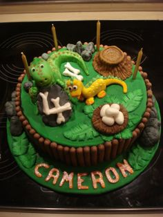 Dinosaur / T rex cake - Lemon cake torted once with Bunnywoman's buttercream. Covered in Fondant with fondant/gumpaste dinosaurs, rocks, tree stump, nest and dino eggs