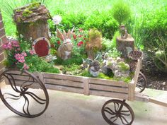 I like the wagon as a planter for a fairy garden (contest is ende - this is a repin) - Fairy Garden in a wagon!  Create your own fairy garden and enter to win $500 in Enchanted Guardians product from Department 56 at http://garden.department56.com/?utm_source=department56.com&utm_medium=homepage&utm_campaign=d56homepagelink ... ENTER TODAY! Photo by Chellie Hailes www.pinterest.com...