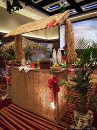 A Tiki bar made by Themed Evenings on a Caribbean theme night #caribbeanpartyideas