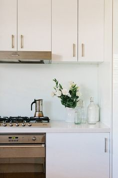 I love this kitchen. It's so clean and simple. I love the white cabinets.
