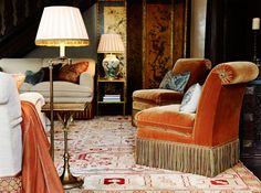 Scroll back chairs uphosltered in orange velvet with bullion fringe