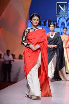 A model in a beautiful cotton saree teamed with boat neck blouse