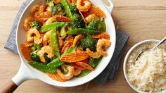 Sesame Shrimp Stir-Fry Skillet - This seafood skillet makes quick work of dinner, using fast-cooking shrimp and precut bagged stir-fry veggies. Veggie Fries, Veggie Stir Fry, Seafood Recipes, Dinner Recipes, Cooking Recipes, Chicken Recipes, Cooking Games, Fish Recipes, Enchiladas