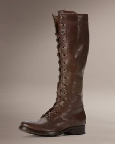 The boots Katniss Everdeen (Jennifer Lawrence) wears in The Hunger Games movie are Melissa tall Lace boots from Frye. Women's Lace Up Boots, Tall Boots, Leather Boots, Laced Boots, High Boots, Katniss Everdeen, The Frye Company, Frye Boots, Combat Boots