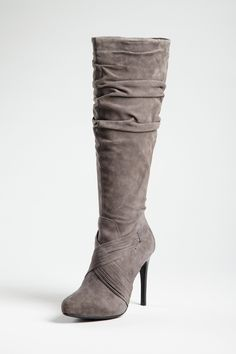"""Slouchy suede finishes this knee-high style with a bohemian-meets-luxe look that is effortless and on-trend.  Pull-on style   Scrunched upper  Criss-cross straps over vamp  - Partial side zip closure  - Stacked 4 1/2"""" heel  3/4"""" hidden platform"""