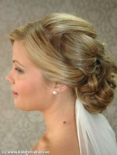 Low chignon is the rage this year for Maui weddings