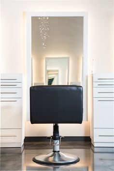 An eight-foot glittering chandelier and one-of-a kind marble-finished flooring welcomes clients to Hermosa Salon in Edmond, Oklahoma, one of our 2017 Salons of the Year. Hair Salon Stations, Salon Software, Cozy Chair, Salon Chairs, Home Salon, Salon Interior Design, Living Room Remodel, Floor Finishes, Beauty Industry