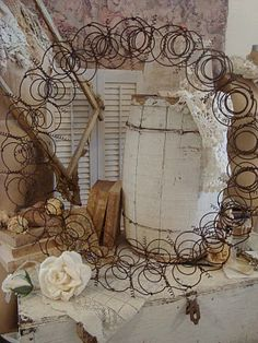 .Wreath from old rusty bedsprings. Love it.