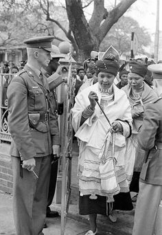 Mama Winnie Mandela in Traditional Xhosa umbhaco at some point it was a crime in S.A to dress like this.