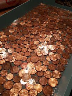 Dienblad van centen in de epoxy