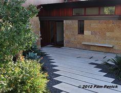 Poured-concrete slabs with Texas Black gravel