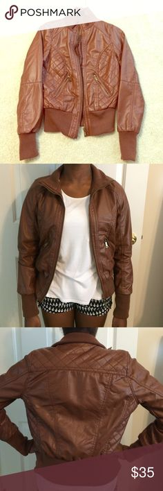 Bomber jacket A chocolate colored bomber jacket with bronzed zipper detailing and quilted leather patterning. The perfect jacket for fall. Jackets & Coats