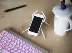 Spider stand ➨ http://uncovet.com/shops/tech/spider-stand?via=HardPin=type337