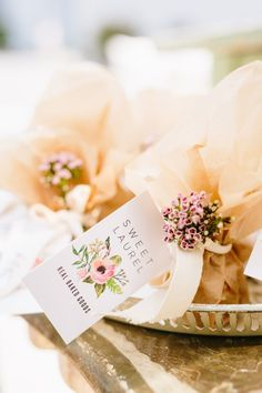 Baked good favors: http://www.stylemepretty.com/living/2016/05/09/the-prettiest-way-to-give-back-this-floral-and-bubbly-party/ | Photography: Jodee Debes