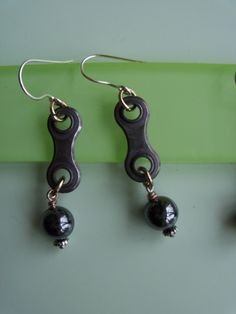 Hematite wire wrapped gemstone earrings linked with used bicycle chain links on Etsy, $12.50