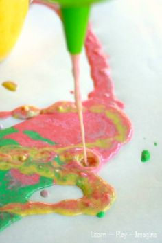 Beautiful and messy art for kids - pour painting with funnels! (using soap paint: flour, soap, water and food coloring)