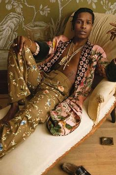 ASAP Rocky wearing Gucci Silk Twill Dress, Gucci Embroidered Twill Flare Pants, Gucci Princetown Leather Slippers