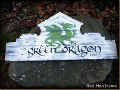 The Green Dragon Inn sign from Red Hen Home Blog.  http://redhenhome.blogspot.com/2014/02/green-dragon-inn-sign.html