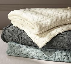 """Cable Knit Throw $67 50"""" wide x 60"""" long Supersoft cotton-acrylic. Features a garland motif border on each end. Machine wash."""